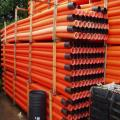 63mm x 6m Orange smooth ducting c/w coupler marked street lighting.